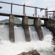 Hydroelectric power plant generates electricity. - Stock Photo