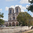 Notre Dame, Paris along the Seine river - Stock Photo