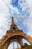 Eiffel Tower against the blue sky and clouds Paris France. — Stock Photo