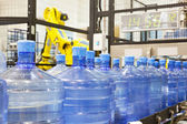 Modern industrial shop on pouring mineral water — Stock Photo
