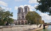 Notre Dame, Paris along the Seine river — Stock Photo