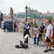 PRAGUE, CZECH REPUBLIC-IYUN 11,2012. Musicians on Charles Bridge in Prague, the Czech Republic, June 11, 2012.Its construction started in 1357 under King Charles IV. - Stock Photo