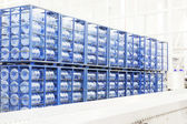 Big constitution for storage of finished goods at a factory on manufacture of mineral water — Stock Photo