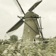Windmill in Kinderdijk, Holland - Stock Photo