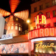PARIS - The Moulin Rouge by night - Stock Photo