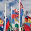 Flags of the different countries against the blue sky - Stock Photo