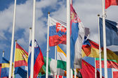Flags of the different countries against the blue sky — Stock Photo