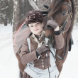 Stok fotoğraf: Womkeeps Arab racer in brown riding habit