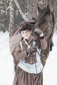 女的在棕色骑乘习惯保持阿拉伯赛车手 — 图库照片