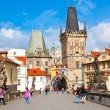 Tourists on Charles Bridge, June 11, 2012, Prague,Czech Republic. — Stock Photo