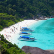 Tourists on a beach on Similan's island, Thailand - Stock Photo