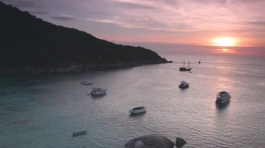 Yachts and boats in calm Andaman Sea during sunset, Thailand — Stock Video