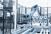 Machine for packing of plastic bottles close up — Stock Photo