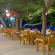 Summer restaurant on the seashore at night — Stock Photo