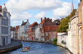 The boat with tourists on the channel, Bruges, Belgium. — Stock Photo