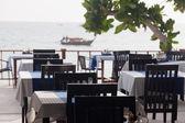 Restaurant verandah overlooking the sea — Stock Photo