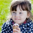 Little girl with ice cream on the street — Stock Photo