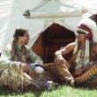 North American Indians sit at a wigwam — Stock Photo