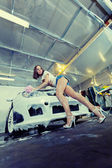 Beautiful girl washes the car — Stock Photo