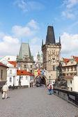 PRAGUE, CZECH REPUBLIC - JUNE 11: Tourists on Charles Bridge, June 11, 2012, Prague,Czech Republic. — Stock Photo
