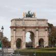 PARIS-OCT 02:Triumphal Arch (Arc de Triomphe du Carrousel) at Tuileries gardens in Paris,France, October 02,2012. The monument was built between 1806-1808 to commemorate Napoleon's military victories — Stock Photo