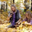 Happy mum and the daughter play autumn park on the fallen down foliage — Stock Photo #28192503