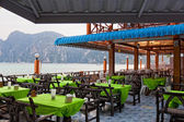 Restaurant verandah overlooking the sea — Stock Photo