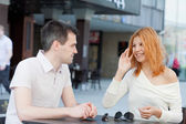 Happy young couple in a cafe — Stock Photo