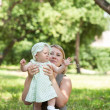 Young mum walks with the child — Stock Photo #30445607