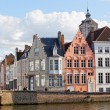 Tourists on the bridge in the ancient city of Belgium-Bruges — Stock Photo