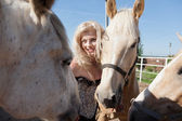 Outdoor portrait of young beautiful woman with horse — Stock Photo