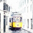 Yellow ancient tram on streets of Lisbon, Portugal. — Stock Photo #33228433