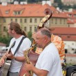Musicians on Charles Bridge in Prague, the Czech Republic — Stock Photo
