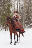 Woman in the brown riding habit — Stock Photo