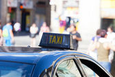 Picture of a taxi shield — Stock Photo