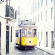 Yellow ancient tram on streets of Lisbon, Portugal — Stock Photo