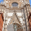 Fragment of a facade of a cathedral in Seville, Spain — Stock Photo #34309363