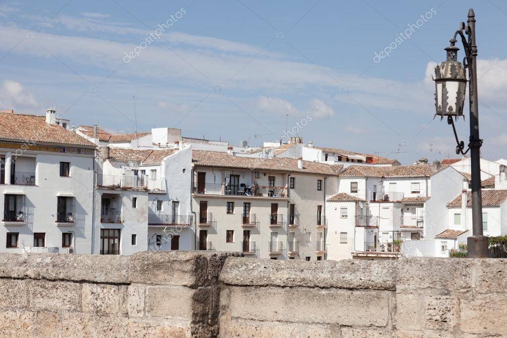 Parapet of Houses Parapet of The Stone Bridge Lamp And White Houses in Ronda Spain Photo