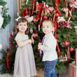 Children decorate a Christmas tree for Christmas — Stock Photo