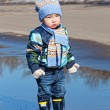 Little boy in rubber boots — Stock Photo