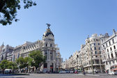 Metropolis building in Gran Via street — Stock Photo