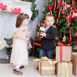 Children play near Christmas fir-trees — Stock Photo