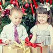 Children and boxes with gifts — Stock Photo