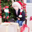 Boy and Christmas gifts — Stock Photo