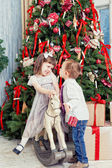 Boy and the girl near Christmas fir-tree — Stock Photo