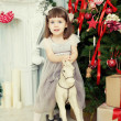 Girl on a toy horse — Stock Photo