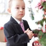 Boy decorate a Christmas tree — Stock Photo