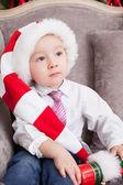 Boy in Santa Claus's cap — Stok fotoğraf