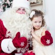 Girl in an elegant dress and Saint Nicolas — Stock Photo
