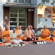 Members of Hare Krishna sit and sing on one of the central streets of Bratislava, Slovakia July 22, 2013 — Stock Photo